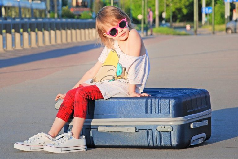 girl with holiday luggage